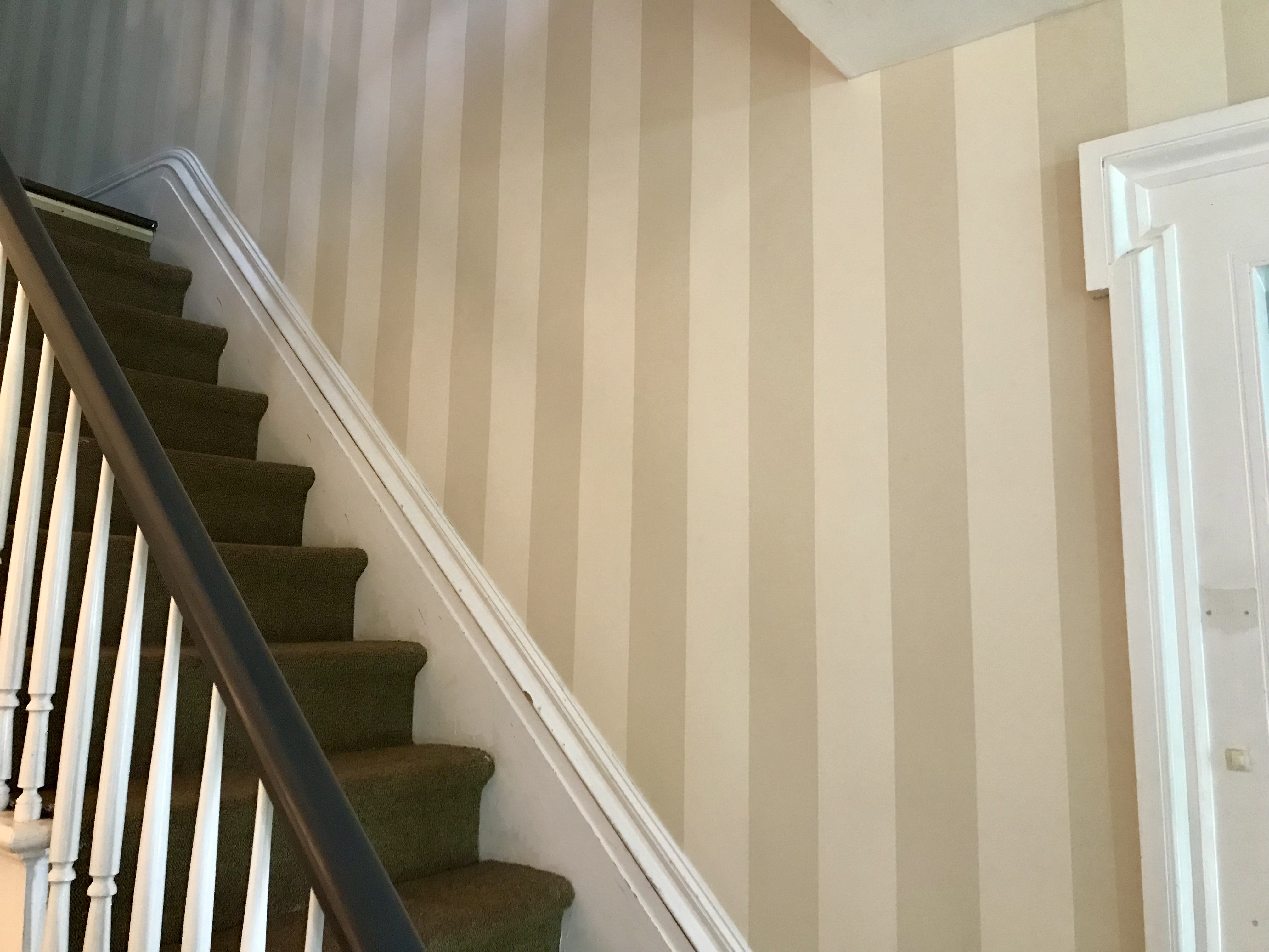 The Foyer - striped wallpaper going up the stairs