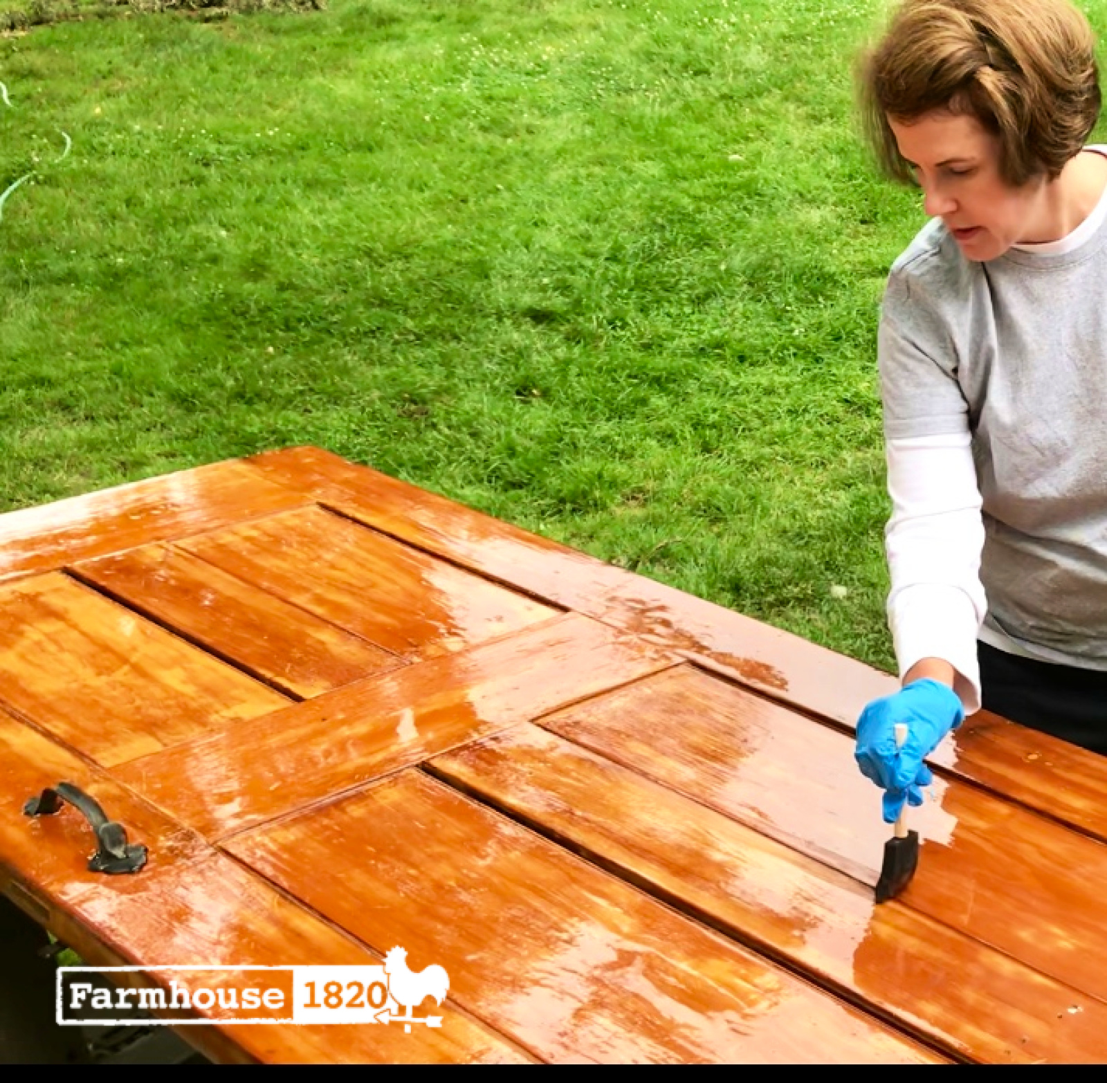 chicken coop - applying marine varnish to an exterior door to withstand the elements