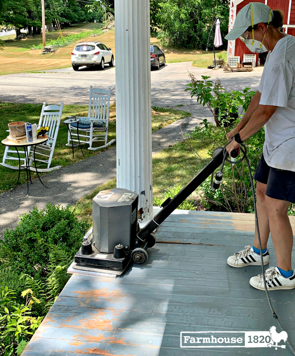 porch - using a stand up power sander on the floor