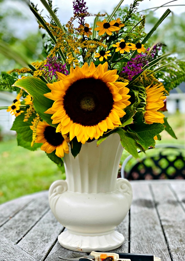 floral arrangement - a winning combination of sunflowers and side of the road finds